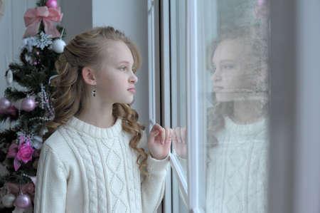 girl at the window Christmas photo