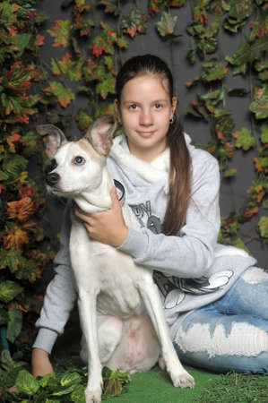 teen girl with her dog  photo