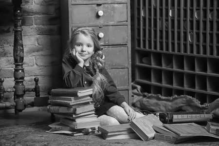 girl with a book in the old library photo