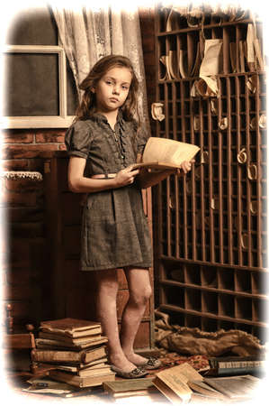girl with a book in the old library Stock Photo - 22001936