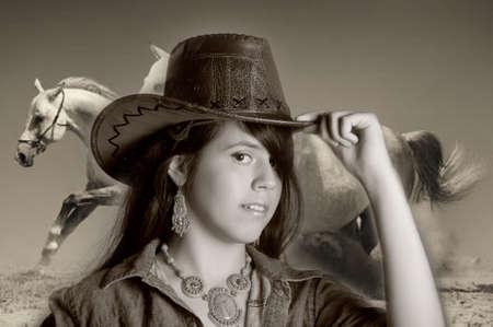 Young girl wearing cowboy hat photo