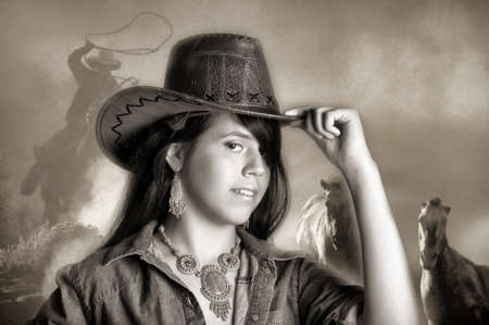 Young girl wearing cowboy hat photo