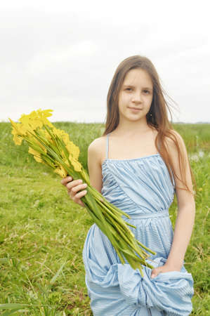 Young girl holding flowers photo