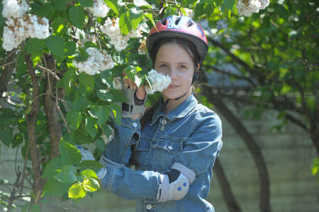 Girl in a helmet and protection on the elbows photo