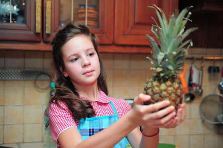 Girl with a pineapple in  hands photo