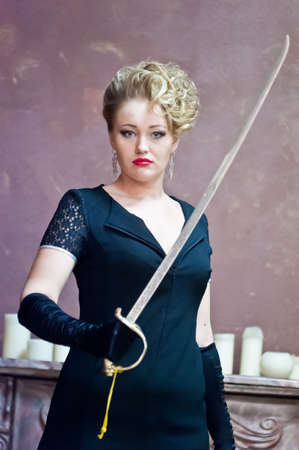 blonde with a sabre in hands photo