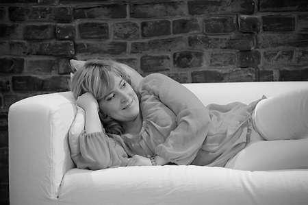 woman lying on the sofa relaxing Stock Photo - 22281803