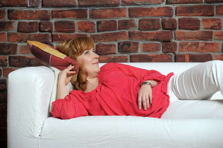 woman lying on the sofa relaxing Stock Photo - 22281805