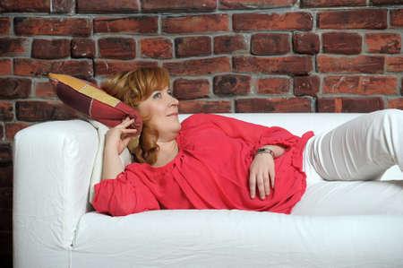 woman lying on the sofa relaxing Stock Photo - 22281805
