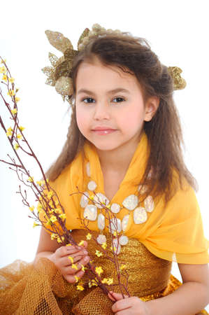 Portrait of a beautiful girl in a gold dress. photo