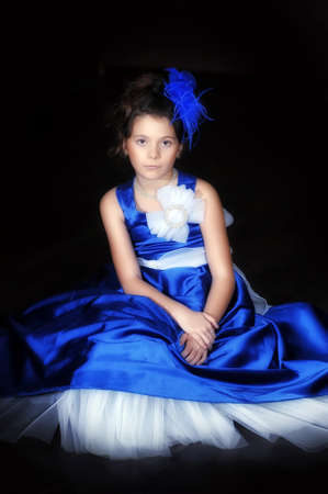 edwardian: Dark-haired girl with beautiful hair in a smart ball gown. Stock Photo