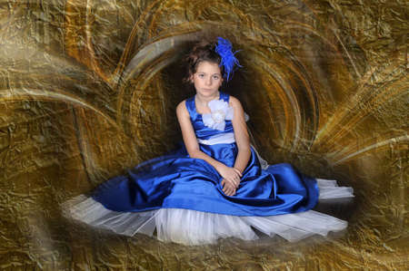 Dark-haired girl with beautiful hair in a smart ball gown. photo