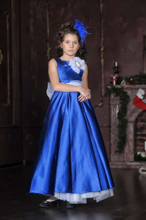 Dark-haired girl with beautiful hair in a smart ball gown. Stock Photo