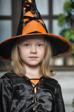 Charming little witch with hat