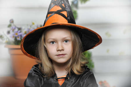 Charming little witch with hat photo