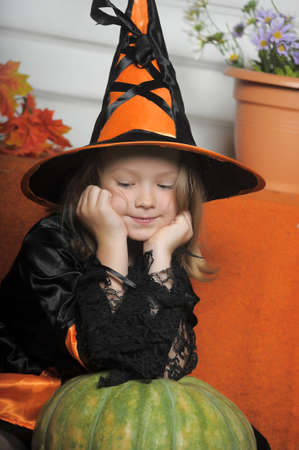 Portrait of girl in witch costume photo