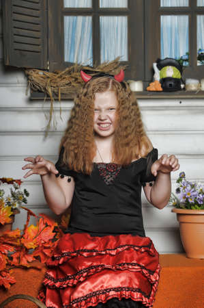she devil: Red-haired girl with pumpkin