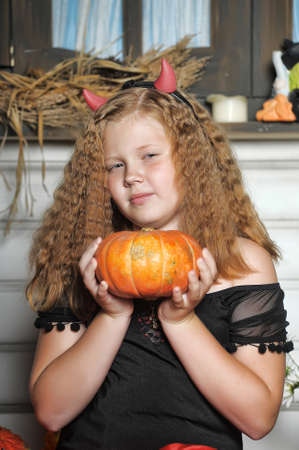 Red-haired girl with pumpkin