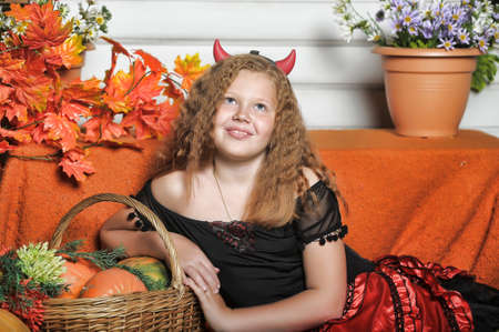 Red-haired girl with pumpkin photo