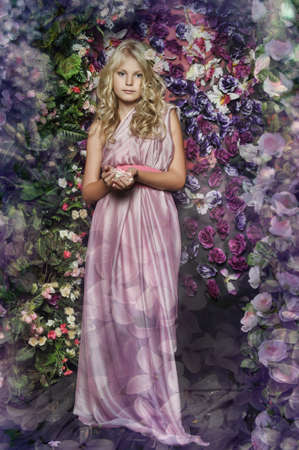 Blonde girl in pink on a floral background  photo