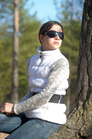 teen girl wearing sunglasses in the spring photo