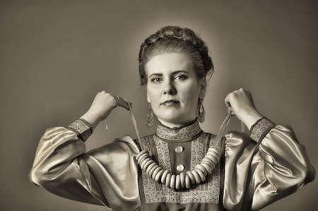 girl in traditional russian folk dress photo