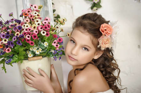 floriculturist: girl and a pot of flowers