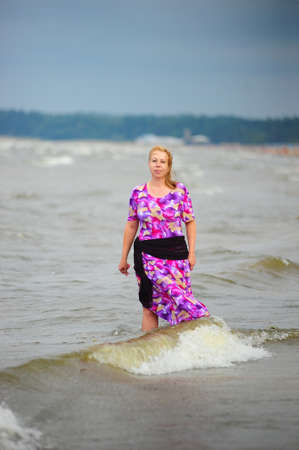 woman walking in the water along the beach Stock Photo - 23235853