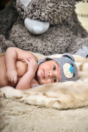 Beautiful baby in gray knitted hat  photo