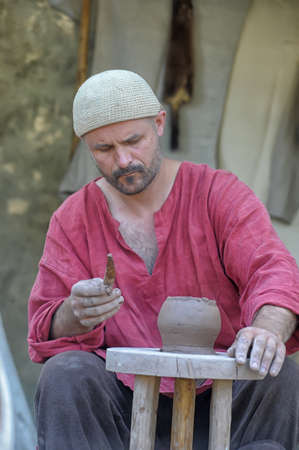 Potter showing his Art Festival on the reconstruction of the early Middle Ages, Volkhov, Russia