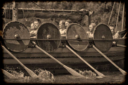 Vikings: Viking ship on the river Editorial