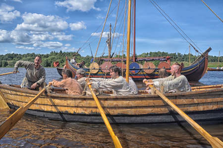 celts: Viking ship on the river Editorial