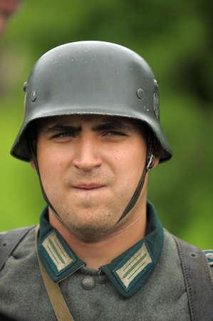 re enacting: Man re-enactor of hostilities of World War II Editorial