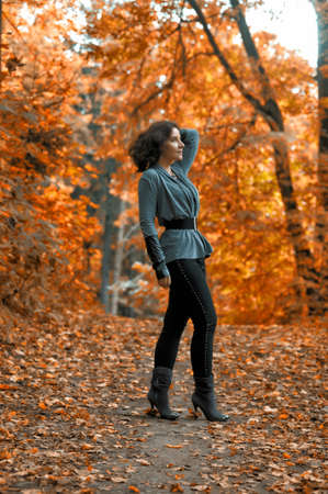 slim girl in a gray autumn park photo