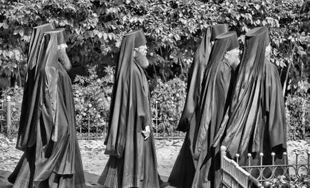 Monks in black are at the service of the church