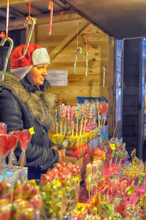 gastronomic: The traditional annual christmas market with illuminated shops at night, Petersburg,  Russia Editorial