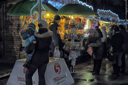 ettal: The traditional annual christmas market with illuminated shops at night, Petersburg,  Russia Editorial