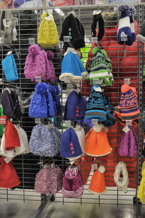 Fashionable and warm winter hats in Decathlon sports shop