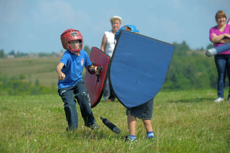 children fighting with shield