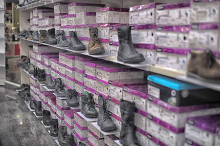 Shelves with shoes in supermarket