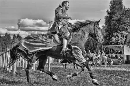 joust: Knight on horse tournaments historic festival, fortress Corell, Priozersk, Russia