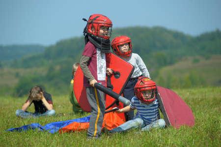 children fighting with shields