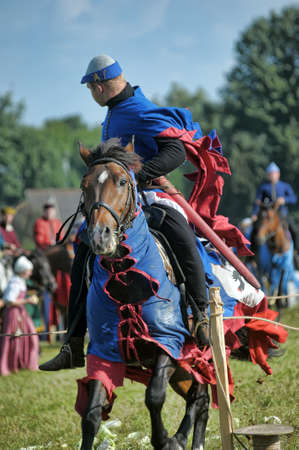 sword act: Knight on horse tournaments historic festival, fortress Corell, Priozersk, Russia