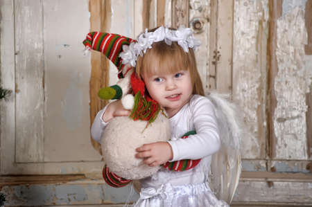 Christmas angel girl in white clothes  photo
