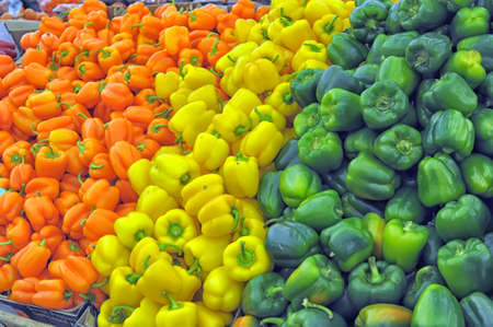Bell peppers in yellow, green and red  photo