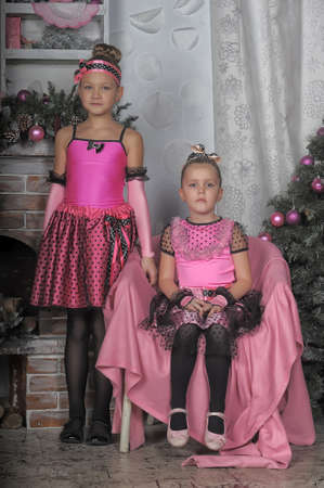 Two girls sisters in pink in Christmas. photo