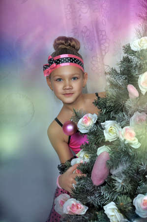 Girl in pink with flowers in Christmas. photo