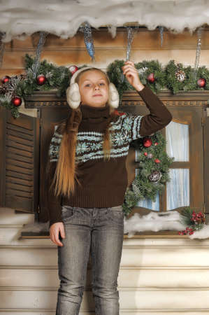 Girl in fur headphones and a sweater  photo