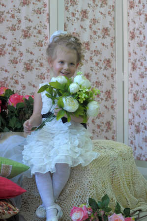 Little girl dressed as princess with flowers  photo