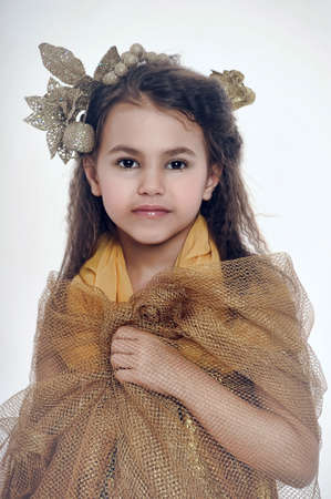 Portrait of a beautiful girl in a gold dress  photo